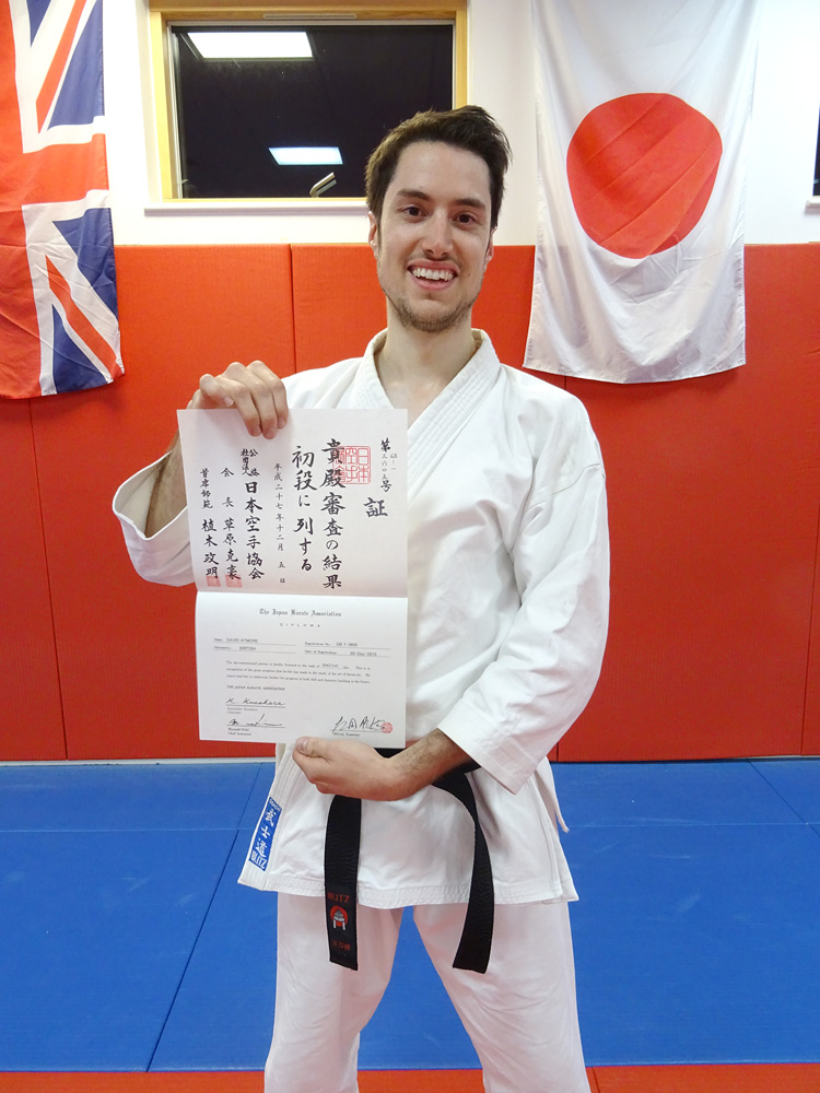 DAVID ATMORE receives his JKA Dan Grade Diploma.