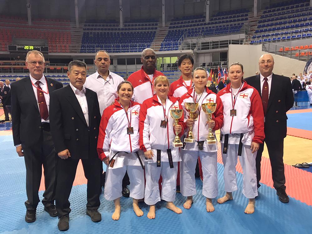 . Sensei Martin with Sensei Ohta, the other referees and the Womens Team who also won Bronze