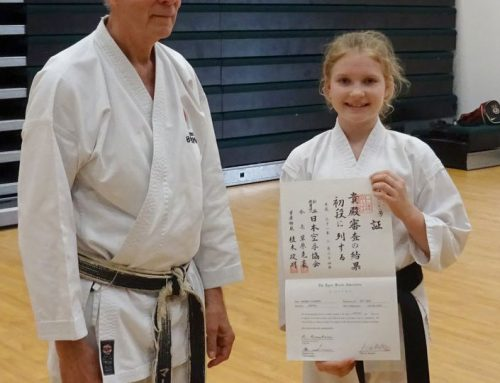 Monika receiving her JKA 1st Dan Diploma from Sensei Martin