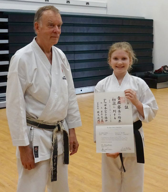 June 2019 - Monika receiving her JKA 1st Dan Diploma from Sensei Martin